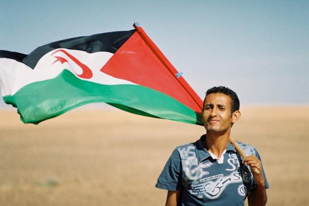 Man with Saharawi flag. Credit: Michele Benericetti
