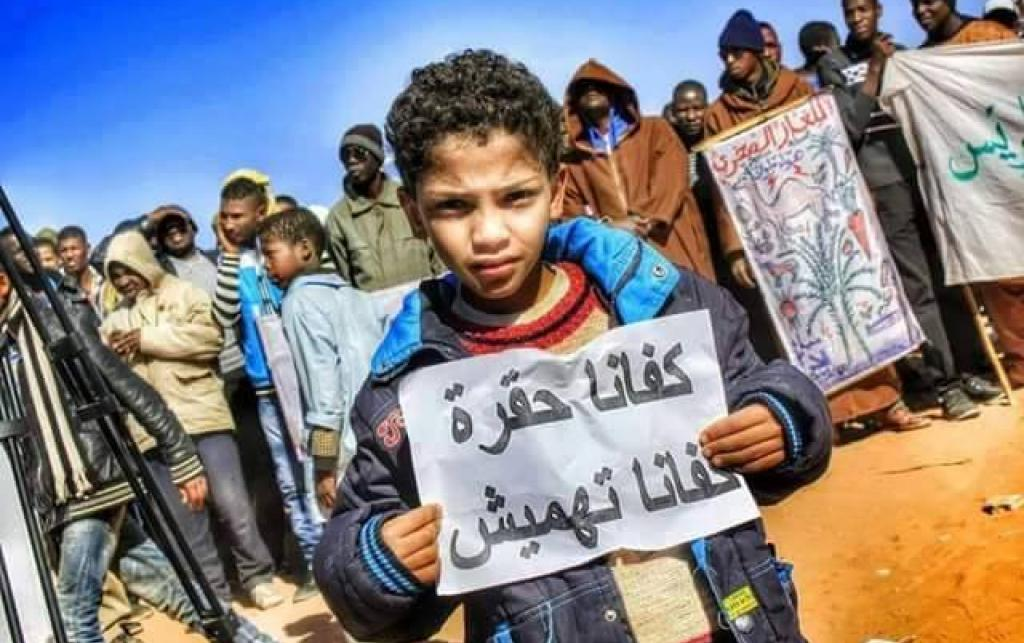 "Picture of an anti-fracking protest in Ouargla, February 2015. The sheet of paper held by the boy says: ""Enough Contempt, Enough Marginalisation"". Credit: BBOY Lee."