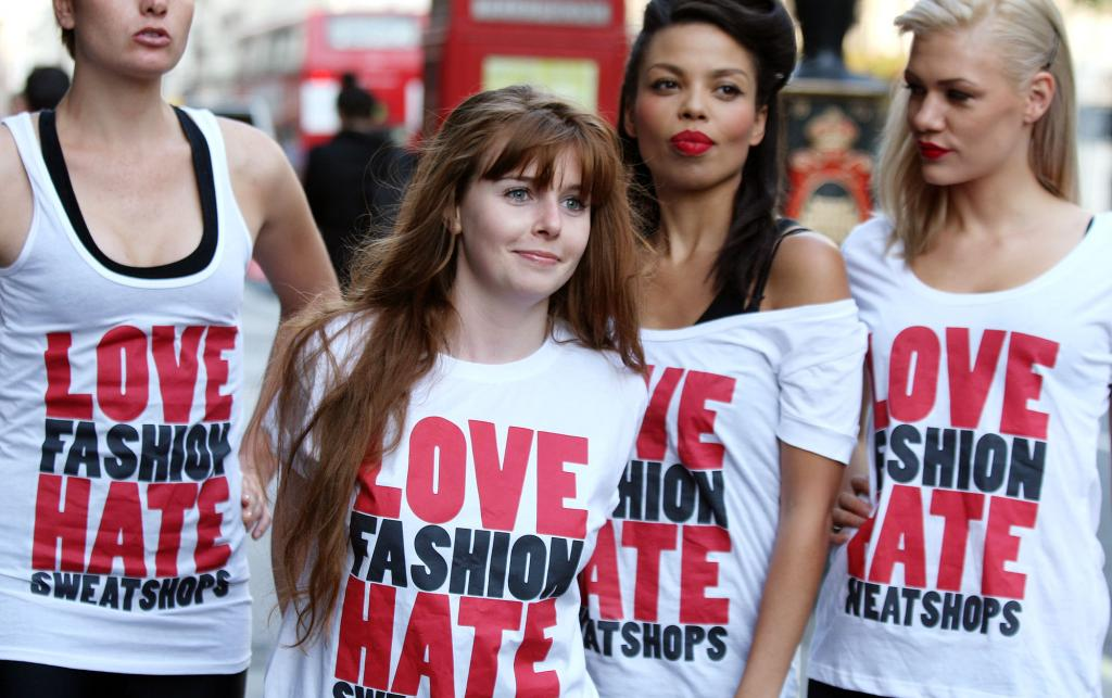 Models and Stacey Dooley campaign against sweatshops at London Fashion Week 2009, wearing 'Love Fashion, Hate Sweatshops' t-shirts.