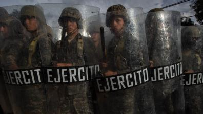 A row of Honduran military holding riot shields during 2017 elections. Photo: Sean Hawkey